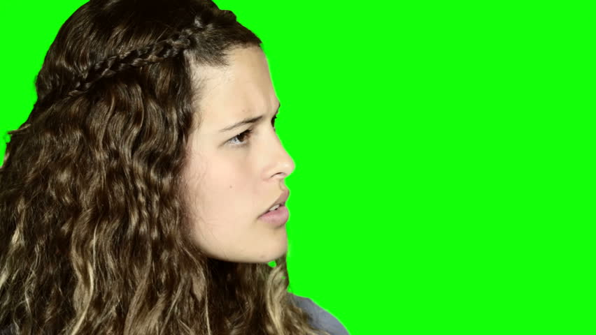 Green screen: Young woman looks to side, listening, is horrified by what she hears, then turns to camera, looking disgusted and nauseated, shaking her head.