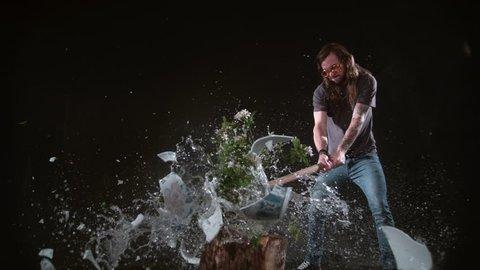 Man smashing vase of flowers with hammer in slow motion, shot on Phantom Flex 4K at 1000 fps