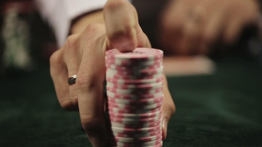 Casino, poker: Man playing poker doing call. Close up