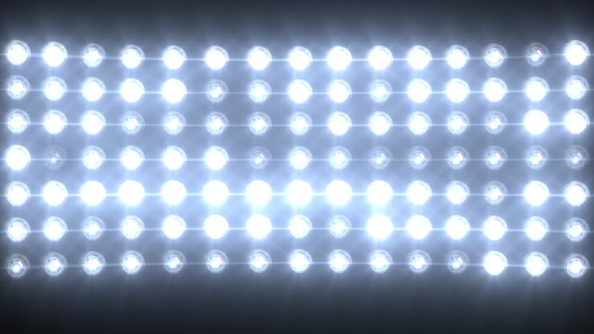 Blue Wall Of Lights Stage Sports Stadium Background Stock: Isolated Shot Of Stadium Flood Lights Turning On A Black