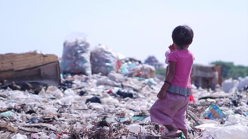 Myanmar, Yangon. 09.11.2013  Children at the dump. Dispossessed orphans. Hungry children looking for food in a landfill.