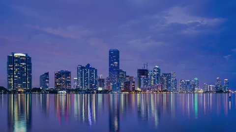 """Miami, Florida skyline over Biscayne bay from day to night. """"ATTN REVIEWER: See an Admin about this batch (re:case #02079696)"""""""