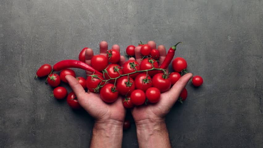 Man hands taking fresh vegetables, harvest concept - stop motion animation