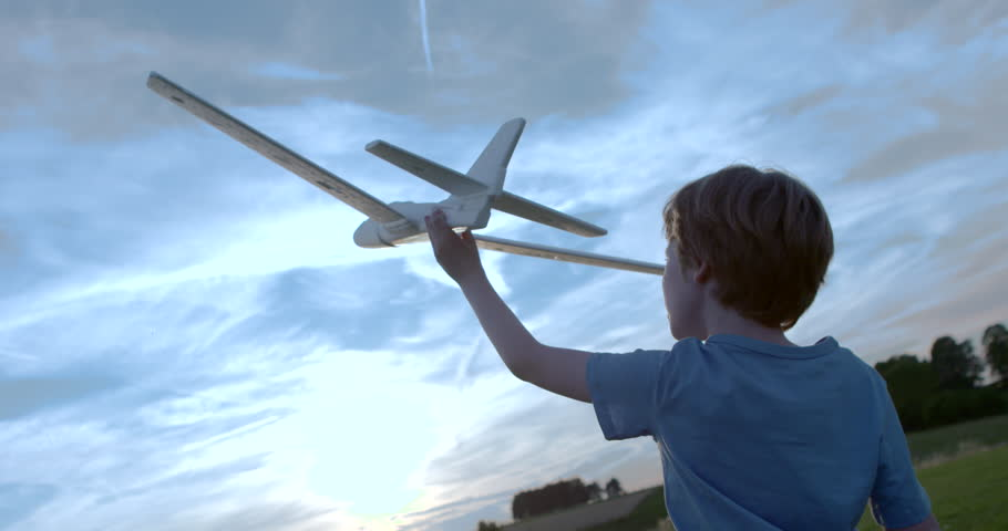 Boy playing outside with toy airplane  slow motion | Shutterstock HD Video #11460374