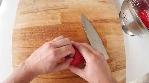 Point of view of man chopping tomato and mushroom