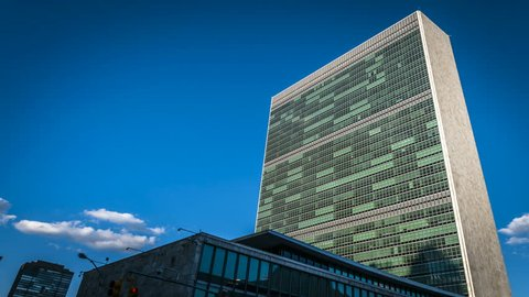 Time Lapse of the United Nations building as the sun sets over New York. After dusk the lights in the UN building make a nice effect.