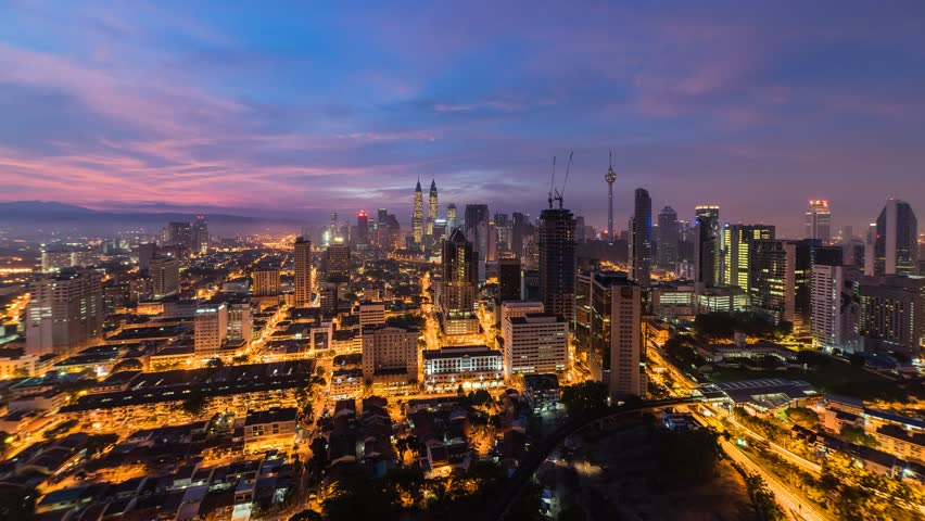 Colorful Kuala Lumpur skyline during sunrise. Time Lapse. 4K resolution. Slide down effect | Shutterstock HD Video #11549501