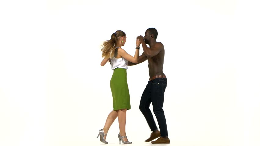 European girl with ponytail and afro american man with naked torso go on dancing social latino dancers isolated on white background | Shutterstock HD Video #11558615