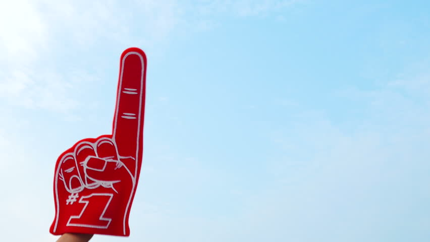 Tailgate: Hand Comes Up With Number One Foam Finger  Extensive video series with football fans at a tailgate party, having fun.  Set in a parking lot outside an arena.  Shot in 4k on Lumix FZ1000.