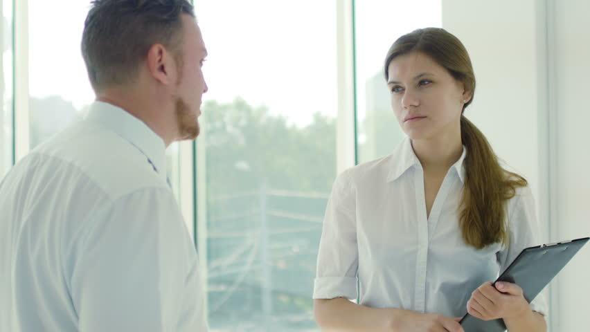 Conversation of business people in office | Shutterstock HD Video #11575082