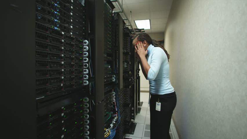 Woman in a server room | Shutterstock HD Video #11604161
