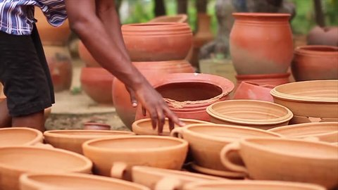 Hands counting Clay pots
