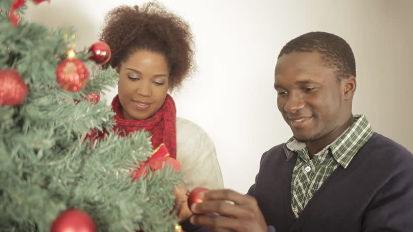 Black couple decorating christmas tree | Shutterstock HD Video #11620451