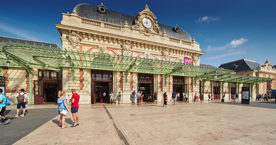 France, Nice, 08.09.2015: Facade of the Train Station Nice Ville, many people with suitcase , 4k timalapse, photography, video, sunny day