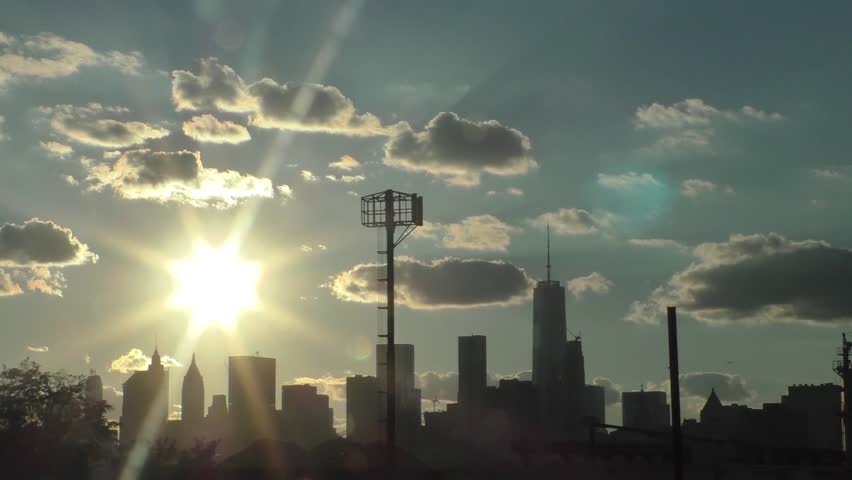 9/11 Memorial Time Lapse - sunset followed by Tribute in Light where the Twin Towers once stood.  This was filmed from Williamsburg, Brooklyn.