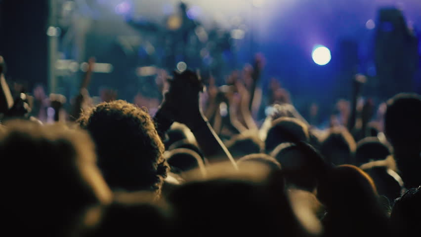 Slow motion big crowd at concert cheering clapping hands.100p-25p conformed super slow motion clip at a night rock concert showing people having fun lifting hands up in the air and applauding. | Shutterstock HD Video #11676761