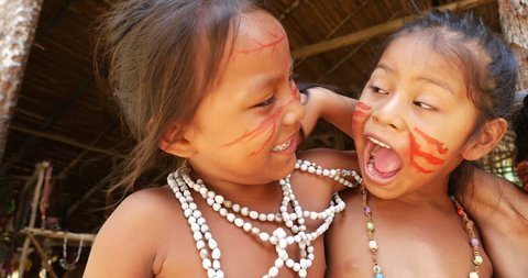 Native Brazilian children playing at an indigenous tribe in the Amazon