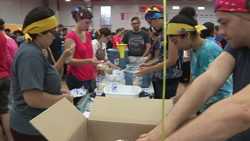 Guelph, Ontario, Canada September 2014 Volunteers package charity food aid for homeless and starving in Africa