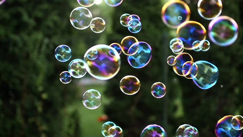 stock video clip of close up of soap colorful bubbles floating