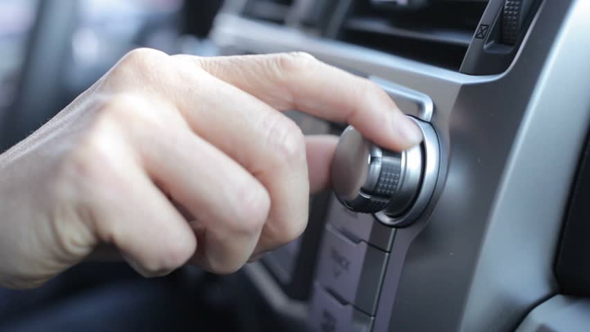 Tuning Radio Volume. Close up of hand adjusting car radio volume | Shutterstock HD Video #11698469