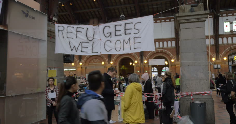 COPENHAGEN, DENMARK - SEPTEMBER 15, 2015: Banner Refugees Welcome is hanged by charity collecting point where locals bring clothes for refugees.