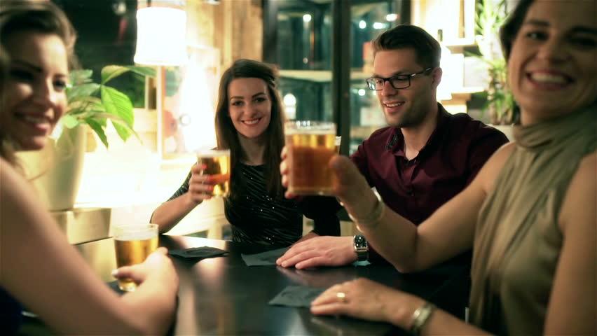 Friends sitting in the pub and invite someone, steadycam shot