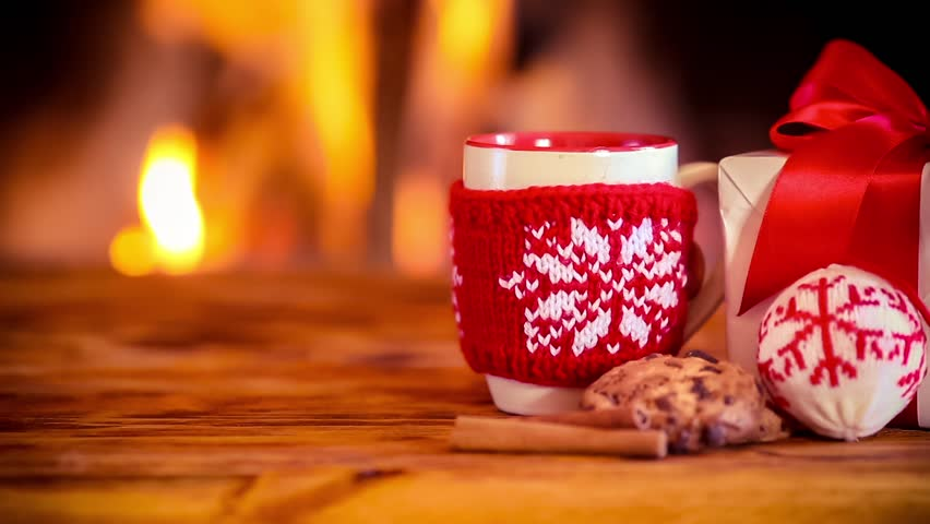 Christmas decorations against fireplace. Xmas holiday concept