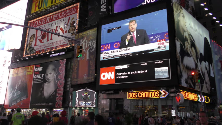NEW YORK - SEPTEMBER 16, 2015: Crowds in New York City's Times Square watch GOP presidential debate on outdoor screens, September 16, 2015