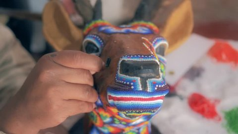 Craftsman making handcraft with colorful beads in 4k