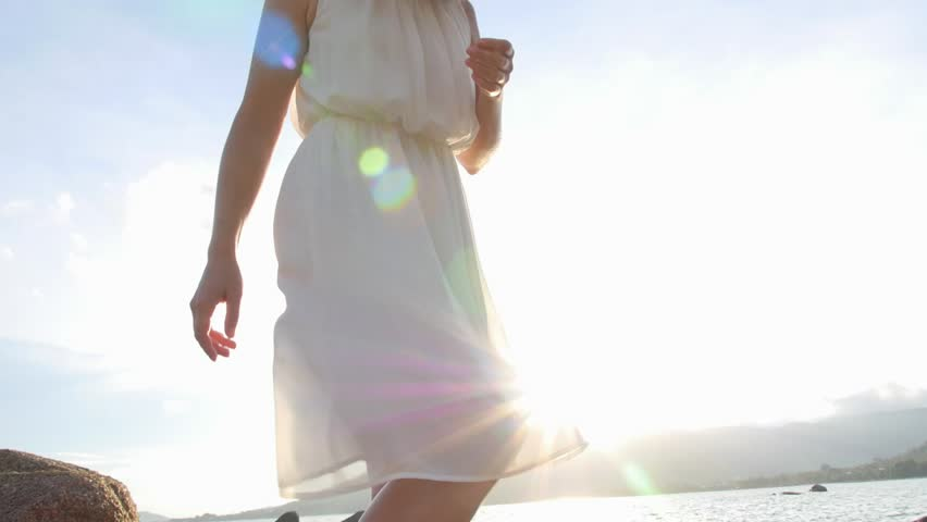 young happy woman in silk dress against bright blue sky slow motion hd