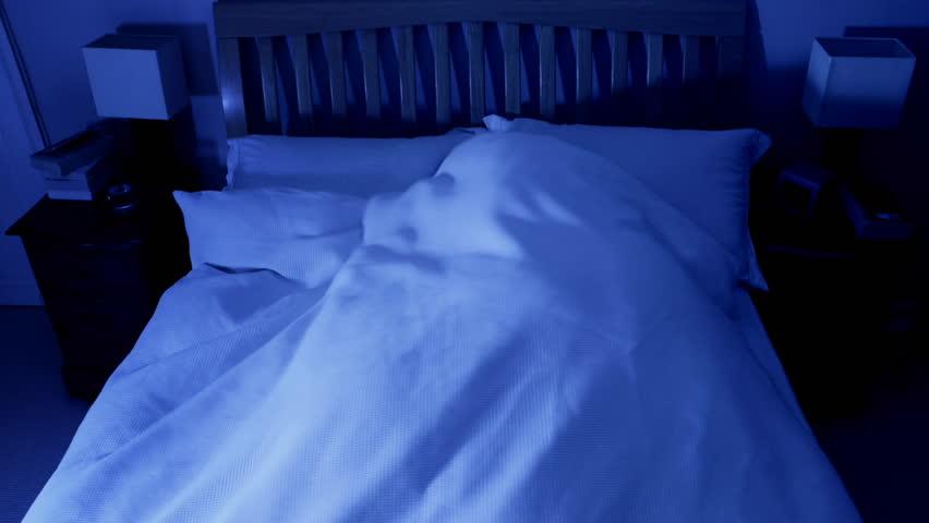 Timelapse of man fitfully sleeping