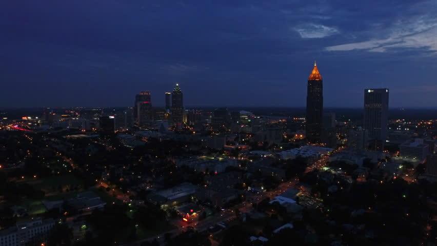 Aerial video of Atlanta Georgia at night. Sunset, thunderstorm.