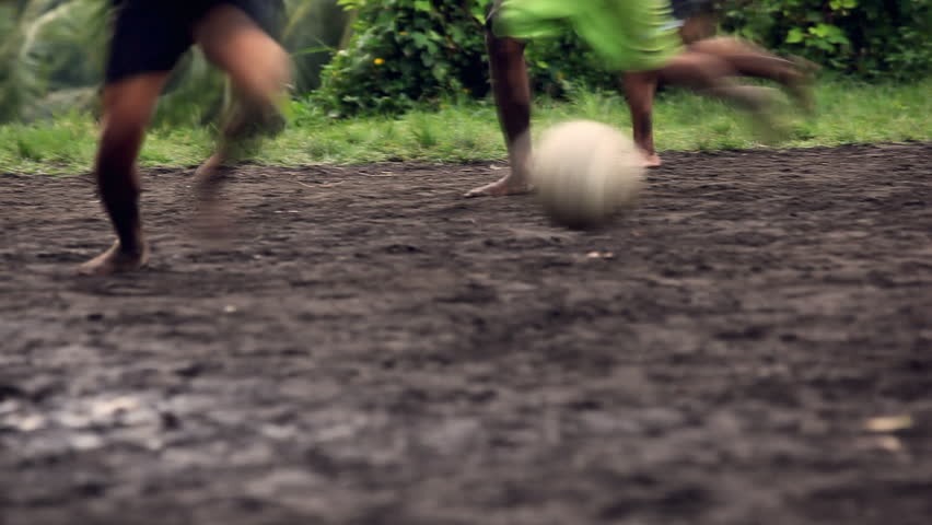 A gang of bar feet kids playing soccer on a muddy field. Serial of slow motion shots with depth of field effects. Action loaded details of running legs and goal shots. [b]HD1080 | 30fps[/b]
