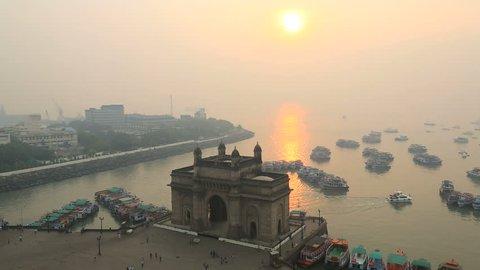 India - March 2015: Mumbai India Gateway India Maharashtra monument sunrise boat building sea city people travel tourist