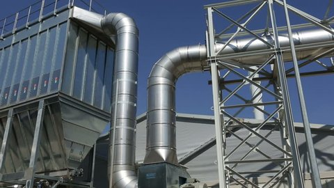 New modern industrial waste plant pipelines from the outside. Waste-to-energy plant. Produces a combustible fuel commodity, such as methane, methanol, ethanol and synthetic fuels.