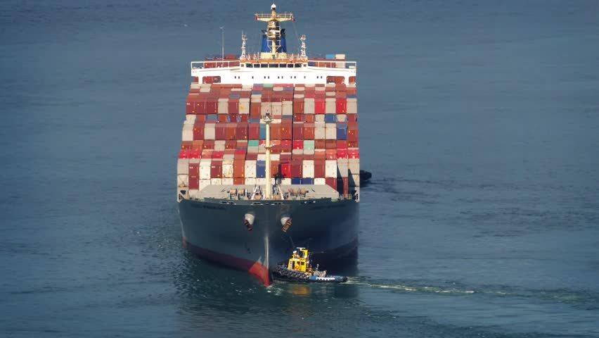 Tug Boats Pushing Freighter Around At Sea | Shutterstock HD Video #11954471