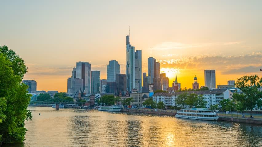 Germany, Hessen, Frankfurt Am Main, City Skyline across River Main, Sunset Day to Night Timelapse