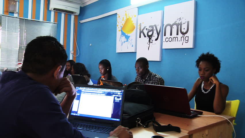 LAGOS, NIGERIA - CIRCA MAY 2014: African startup company. 'Kaymu' employees work on laptop computers. Kaymu is an online marketplace for emerging countries. 1080p HD.
