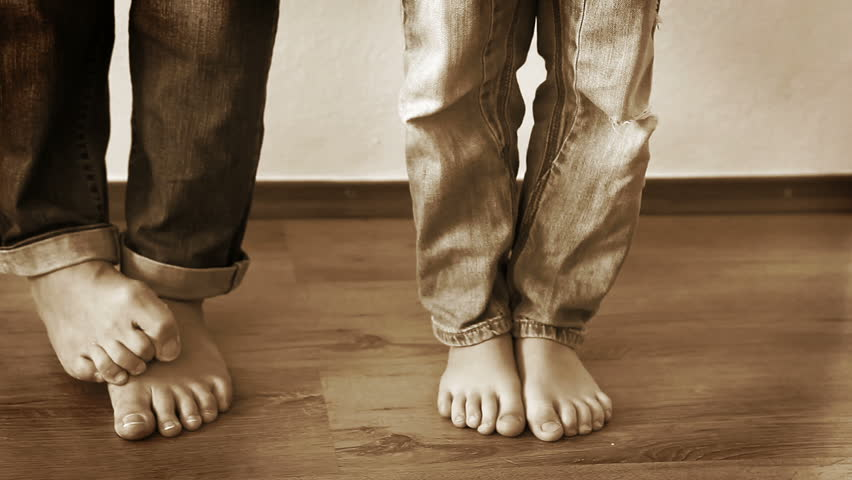 Mother And Son Step On Each Other S Feet As A Prank Stock