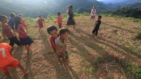 YENBAI, VIETNAM - SEPTEMBER 2015: Native happy hmonk kids playing on the mountain near the village.