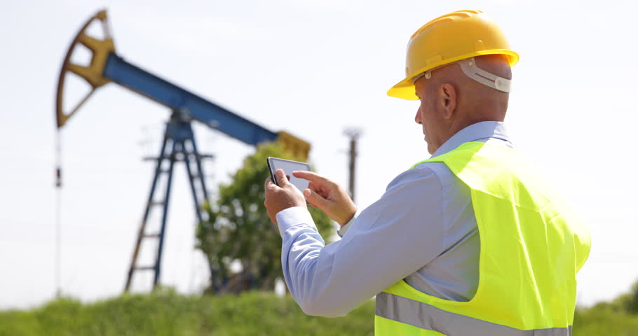 Stock Video Clip Of Oil Foreman Use Tablet Planning Maintenance Schedule |  Shutterstock