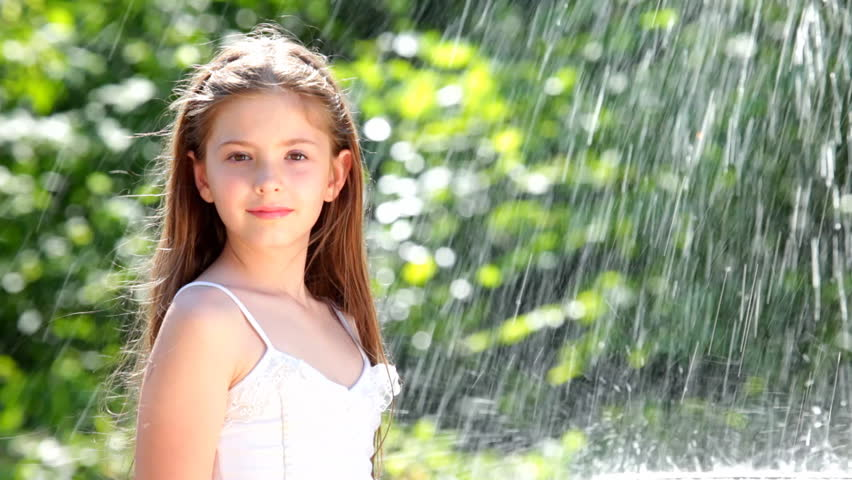 Little Girl And Water Drops Stock Footage Video 1201858 -8986
