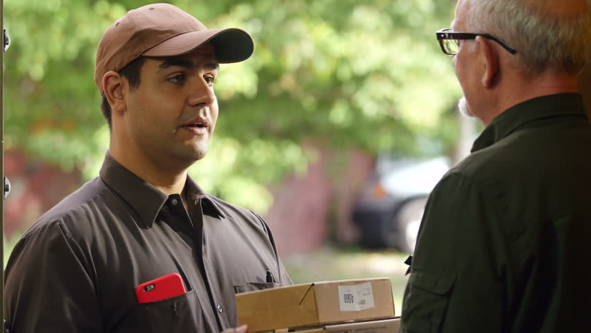 Delivery man delivering package to customer at home, close up