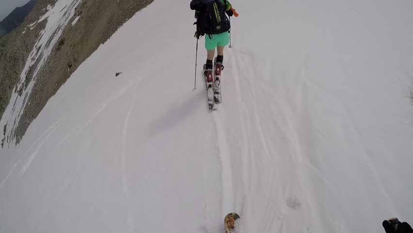 The descent from the high mountain skiing on fresh snow | Shutterstock HD Video #12065741