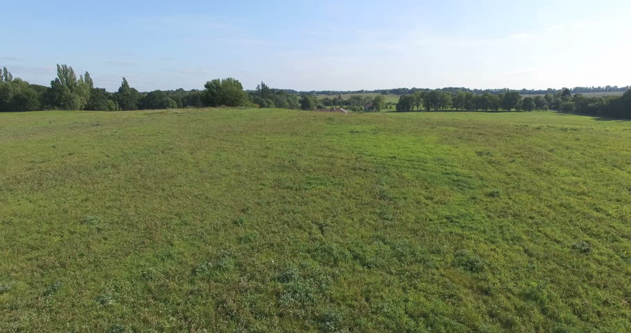Grass field aerial Athletic House Is In The Field Flight From Knoll Shutterstock Hd Video 12067691 Hdfootagestockcom Grass Field Landscape Rural Aerial Scene Royalty Free Video