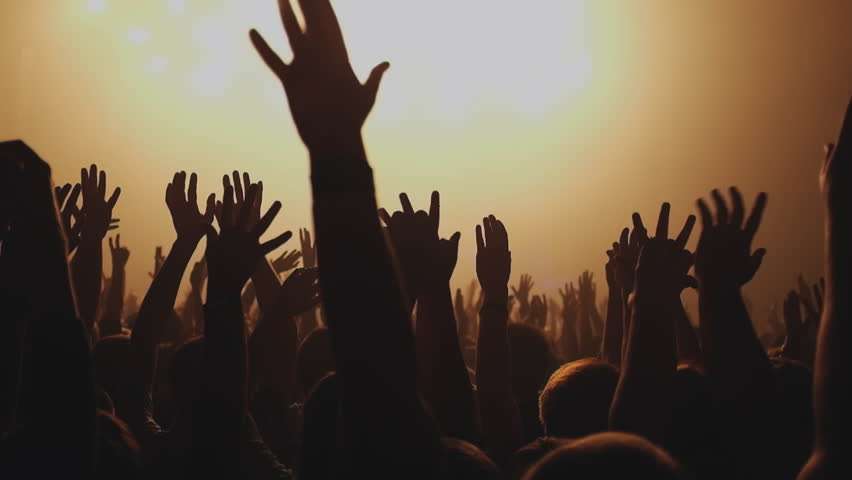 Lot of people clapping at rave party. Here is  footage of people crowd partying at a concert or a night club. You can see dark silhouettes dancing, jumping and waving hands in front of stage.   | Shutterstock HD Video #12190862
