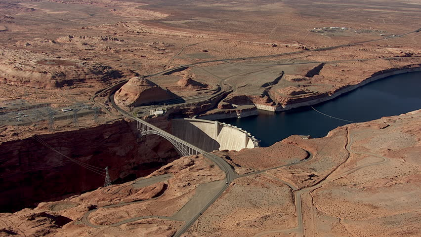 WS TS AERIAL View over cars crossing Powell bridge over lake / Grand Canyon National Park, Utah, United States