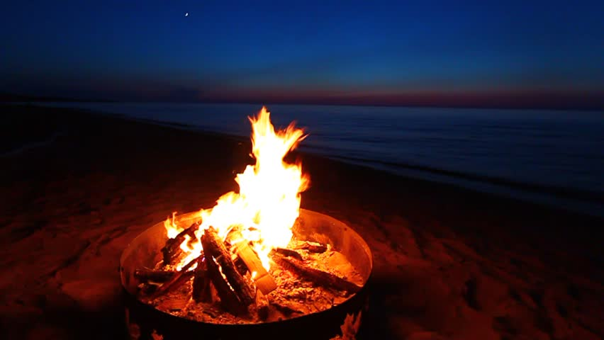 Campfire at sunset along the beautiful beach of Lake Superior in northern Michigan | Shutterstock HD Video #1225711