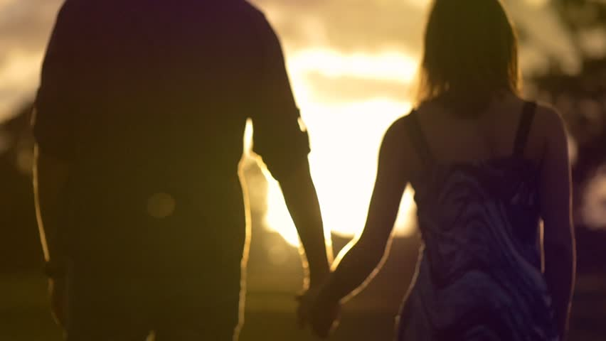 Young couple in loving relationship holding hands walking sunset lifestyle | Shutterstock HD Video #12266498