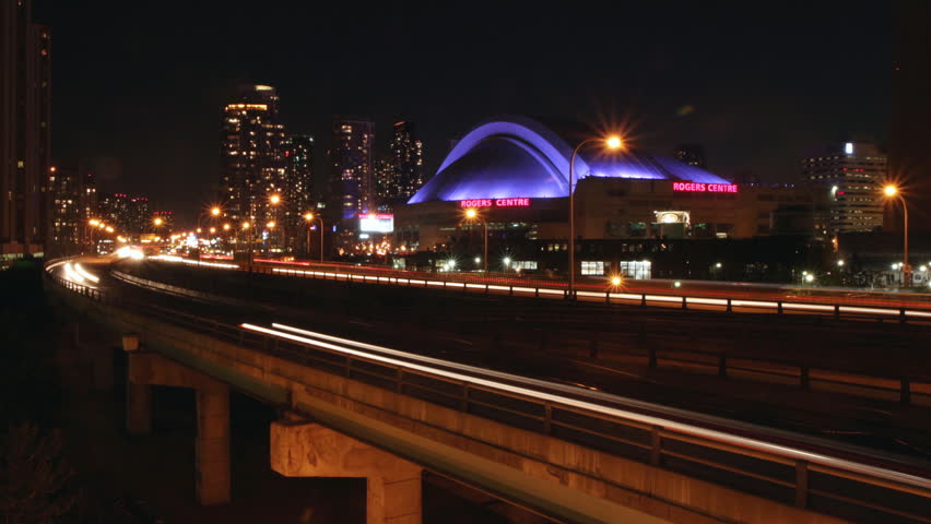 TORONTO - JUNE 4: Traffic with Rogers Centre (formerly Skydome) in Toronto, Ontario, Canada on June 4, 2010. Opened in 1989, it was the first stadium to have a fully retractable motorized roof